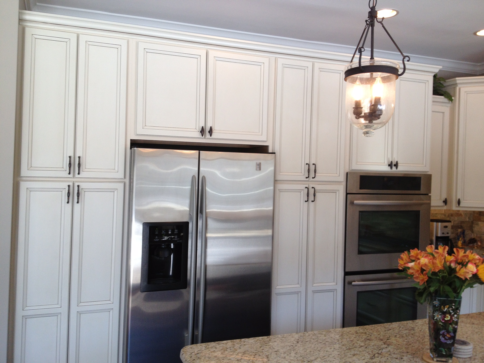 Stainless refrigeration and tall cabinets
