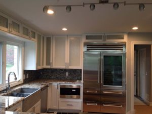 Light cabinets with large refrigerator and wine storage