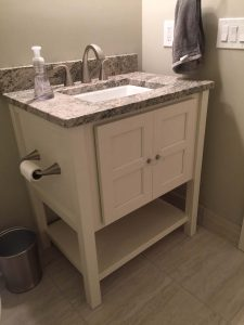 White Vanity with underneath storage shelf