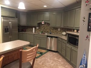 Gray painted Cabinets with stainless appliances