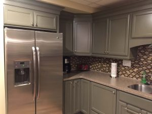 Gray cabinets with refrigerator