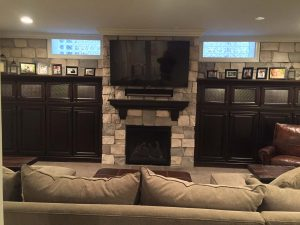 TV above fireplace with custom cabinets