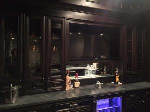 Dark kitchen with tall Cabinets