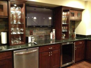 Dark Kitchen with class storage, TV, and appliances
