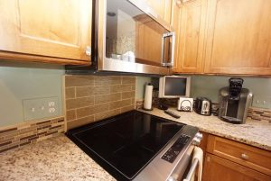 Cabinets with countertop and Cook top with microwave vent